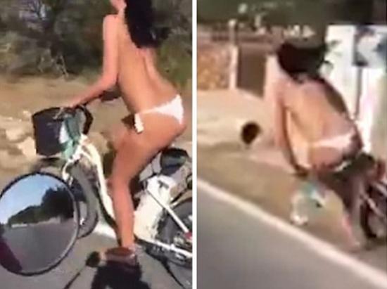 Mulher se exibe andando de bicicleta s� de cal�inha  e cai um tombo no meio da rua